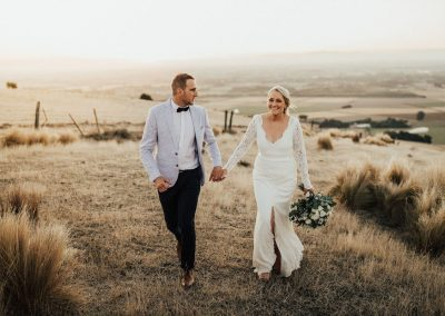 Bride and Groom strolling overlooking the Canterbury Plains at Waipuna