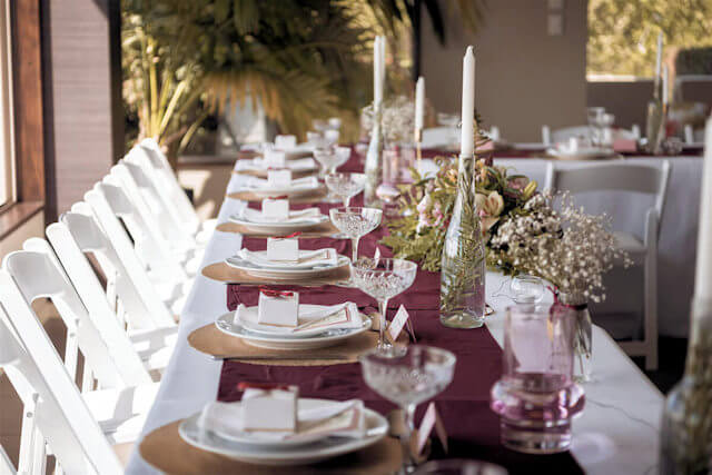 Wedding dinner table arrangement at Waipuna