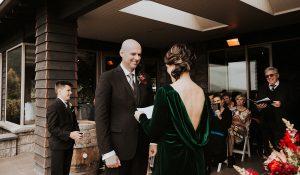 Exchanging wedding vows at Waipuna Christchurch wedding venue