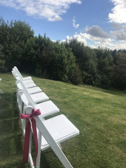 white chairs at wedding