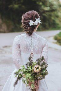 Bride holding florals behind her back