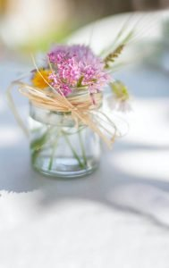 Floral centrepiece in a far with twine