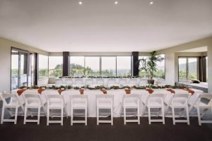Long trestle tables with white chairs